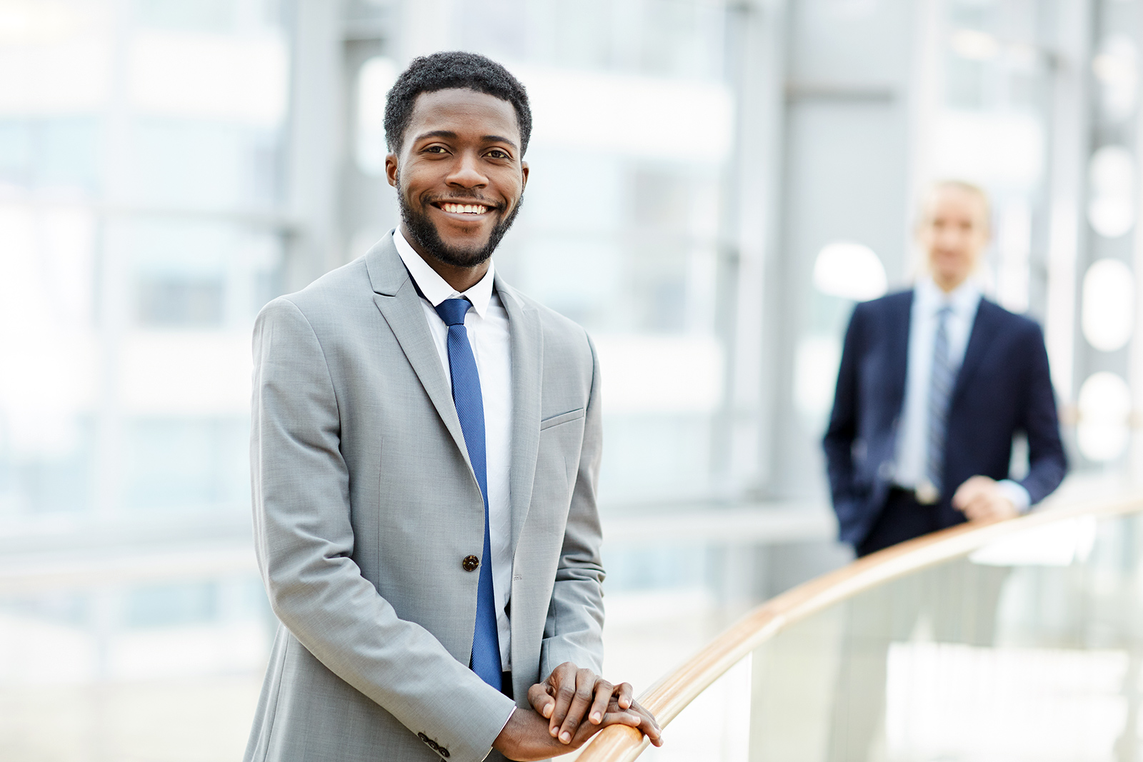 smiling-black-businessman-LUTNGCF.jpg